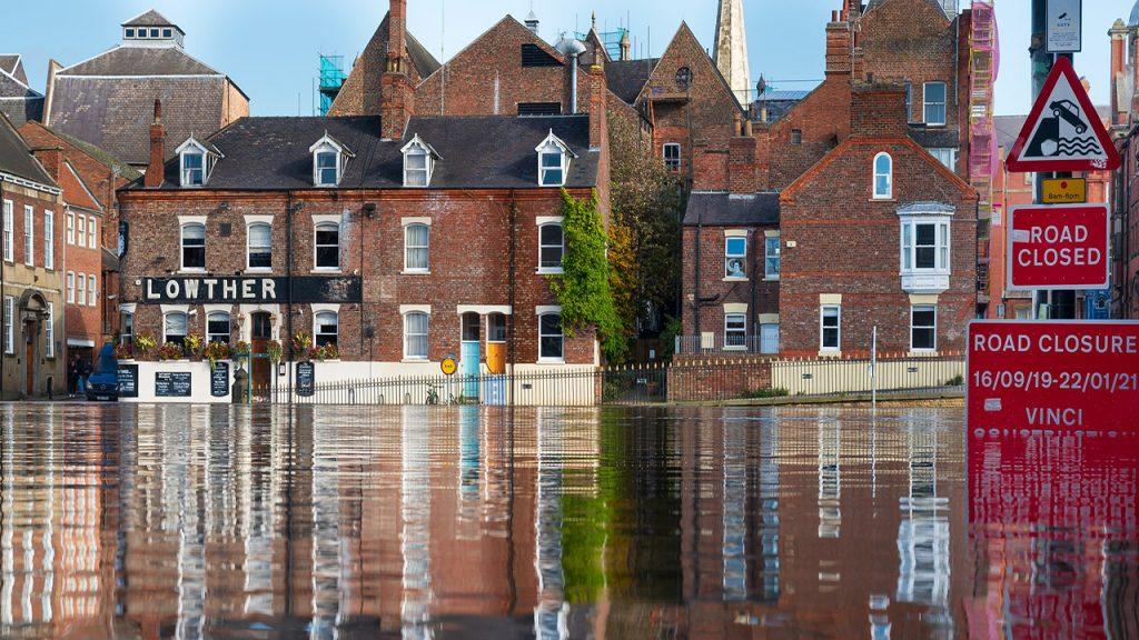 A row of flooded redbrick buildings
