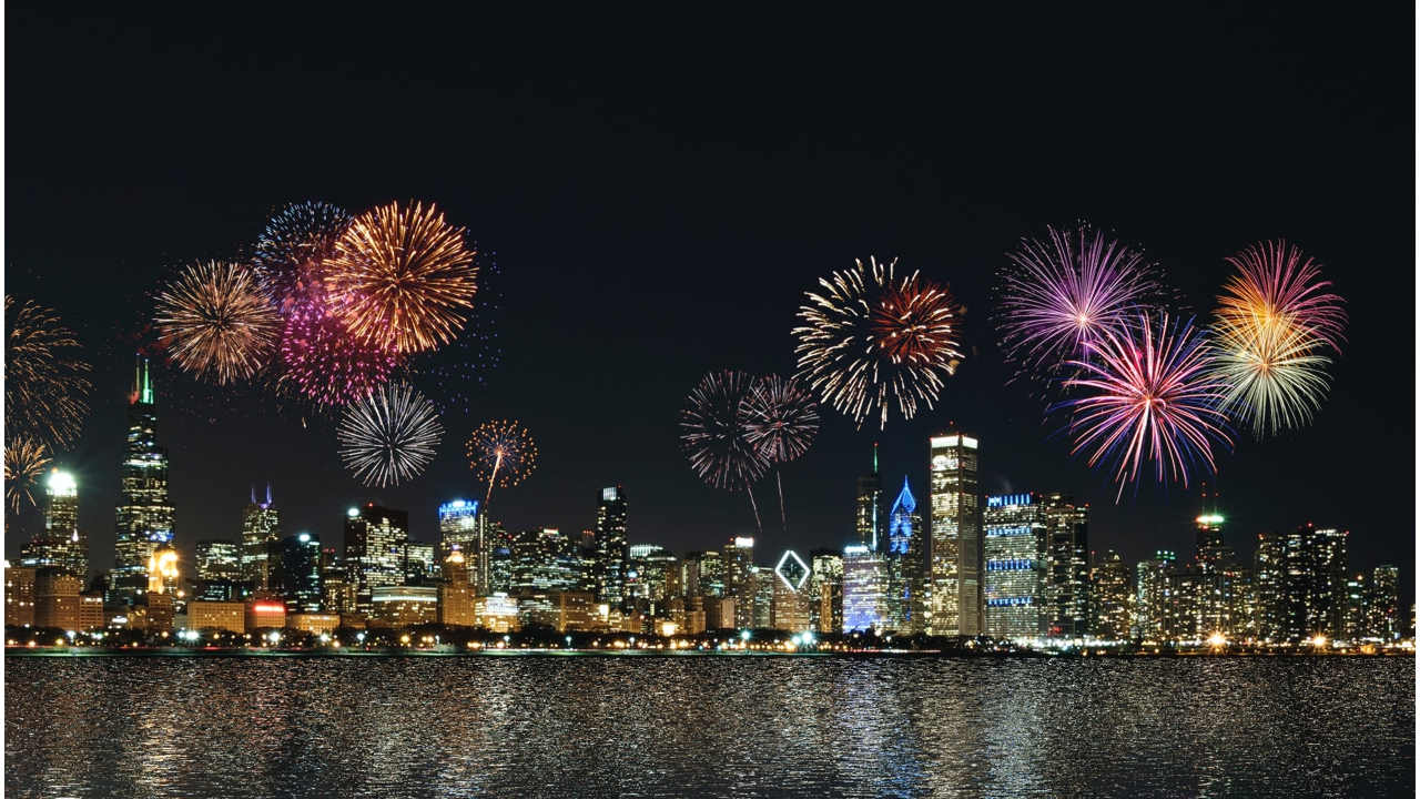 Colourful firework display over a cityscape