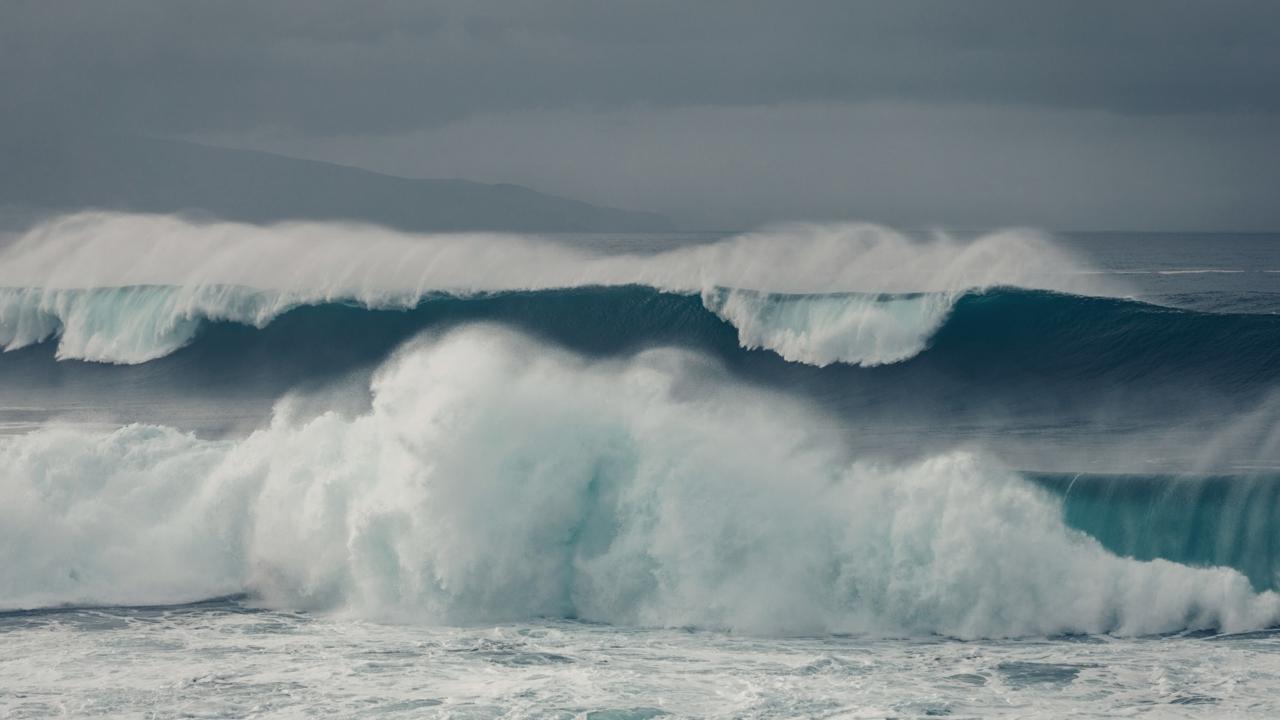 White waves crash towards the shoreline