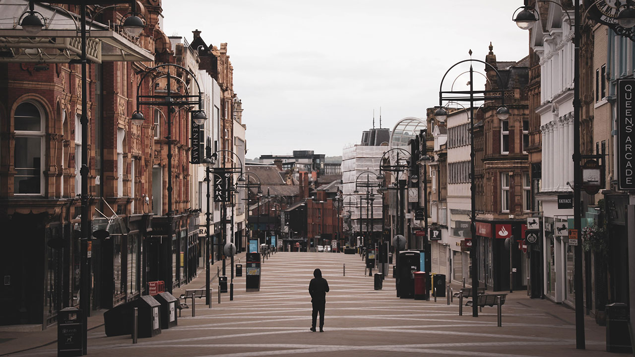 Man walks alone down Leeds high-street