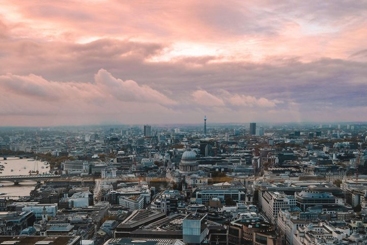 London city centre underneath dramatic, pink, cloudy sky