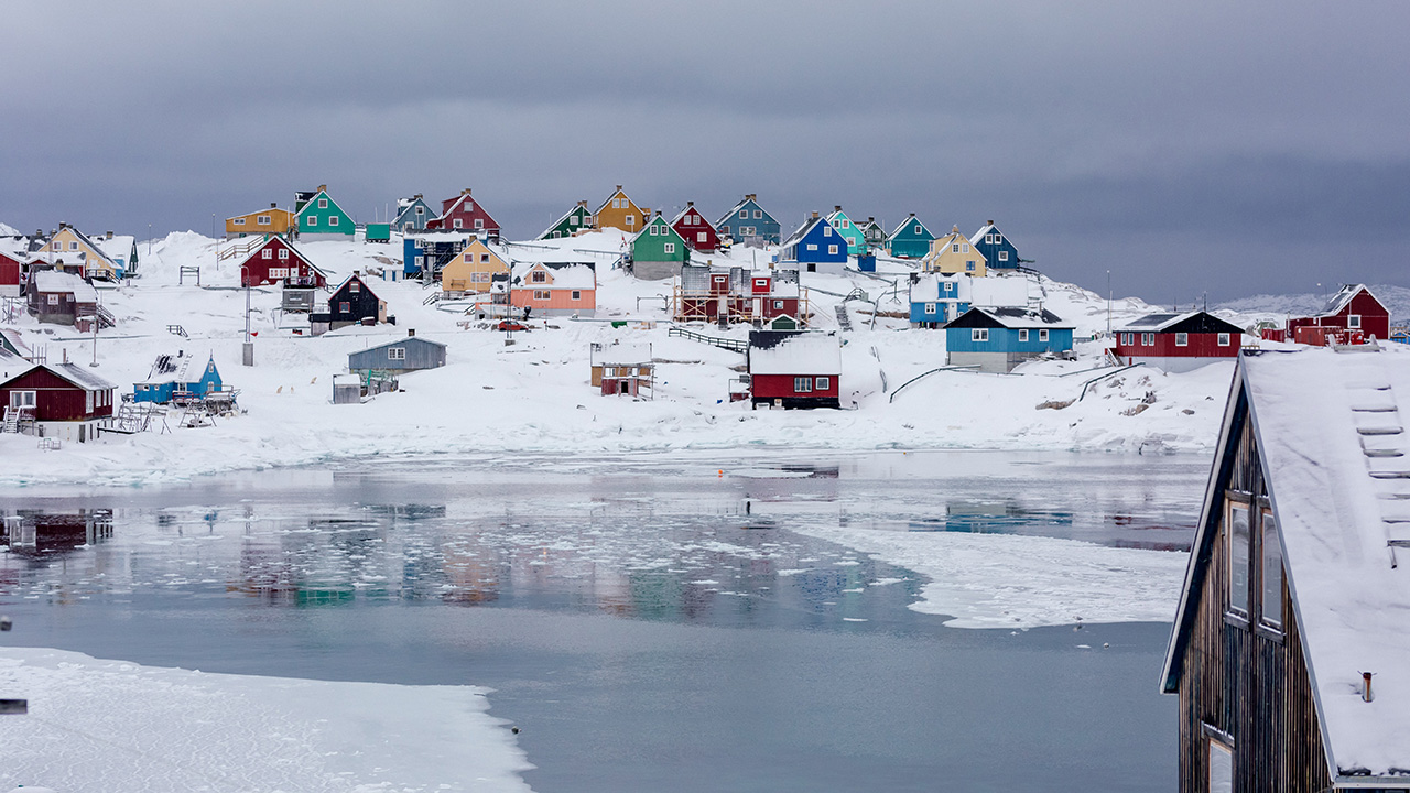 Brightly coloured houses, surrounded by snowy landscape in Greenland