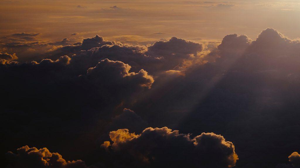 Dark clouds tinged with orange light