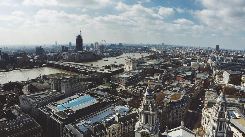 London skyline below a blue cloudy sky