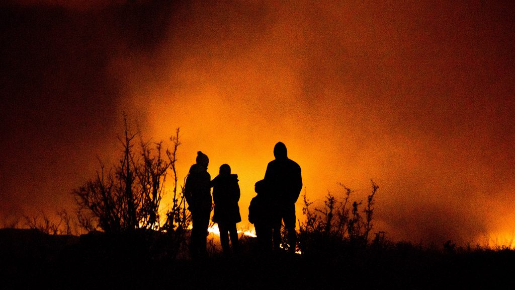 Family watch wildfires rage at night